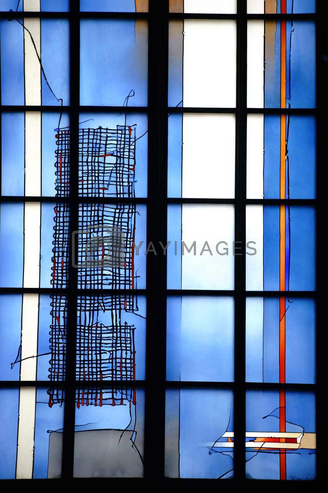Mainz, Germany - September 04, 2015: The blue painted new and modern chapel Window of the sacraments chapel and the cross altar in the Mainz Cathedral on September 04, 2015 in Mainz.