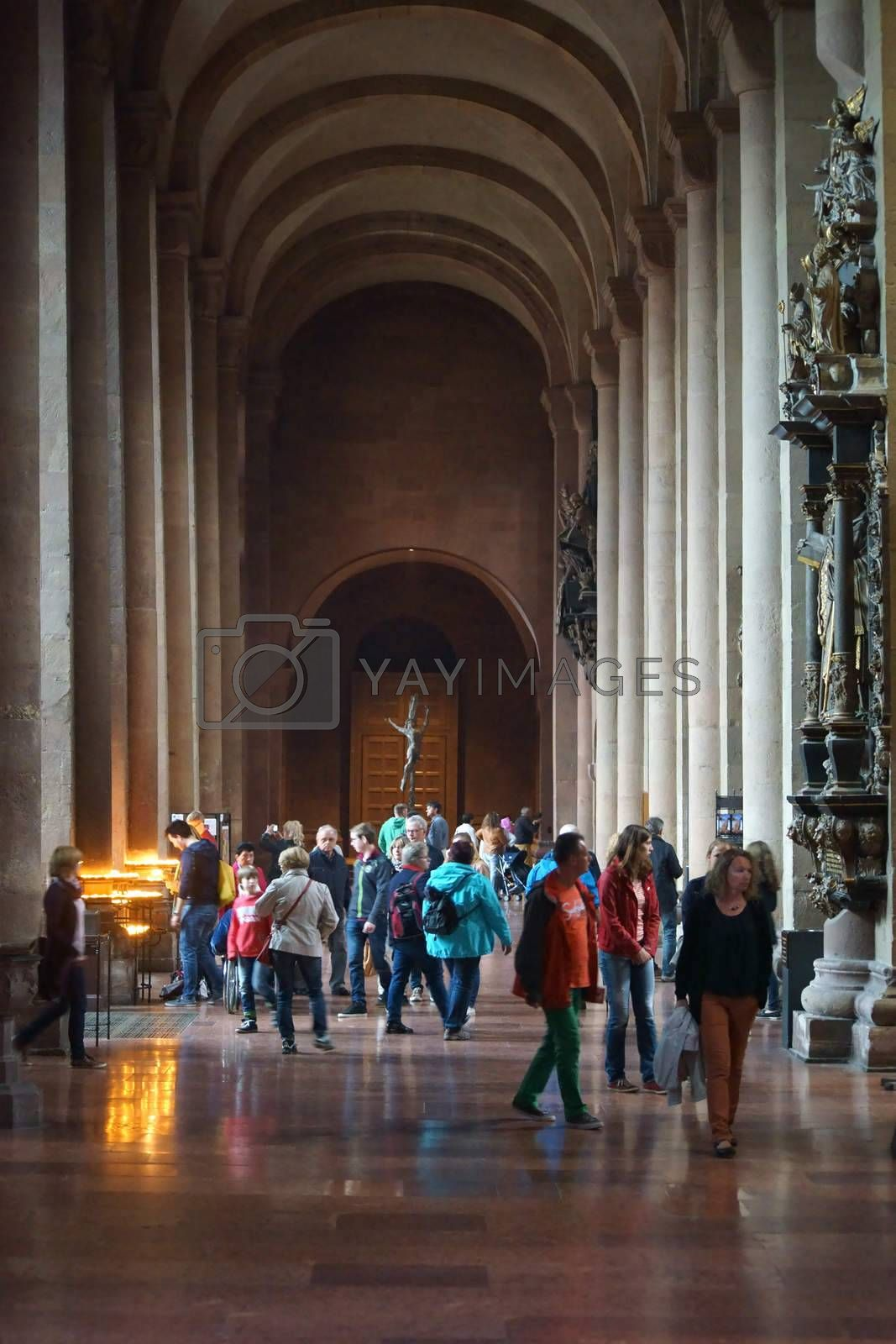 Mainz, Germany - September 04, 2015: The beginning and the pillar vault of the Mainz Cathedral with visitors and religious art on September 04, 2015 in Mainz.