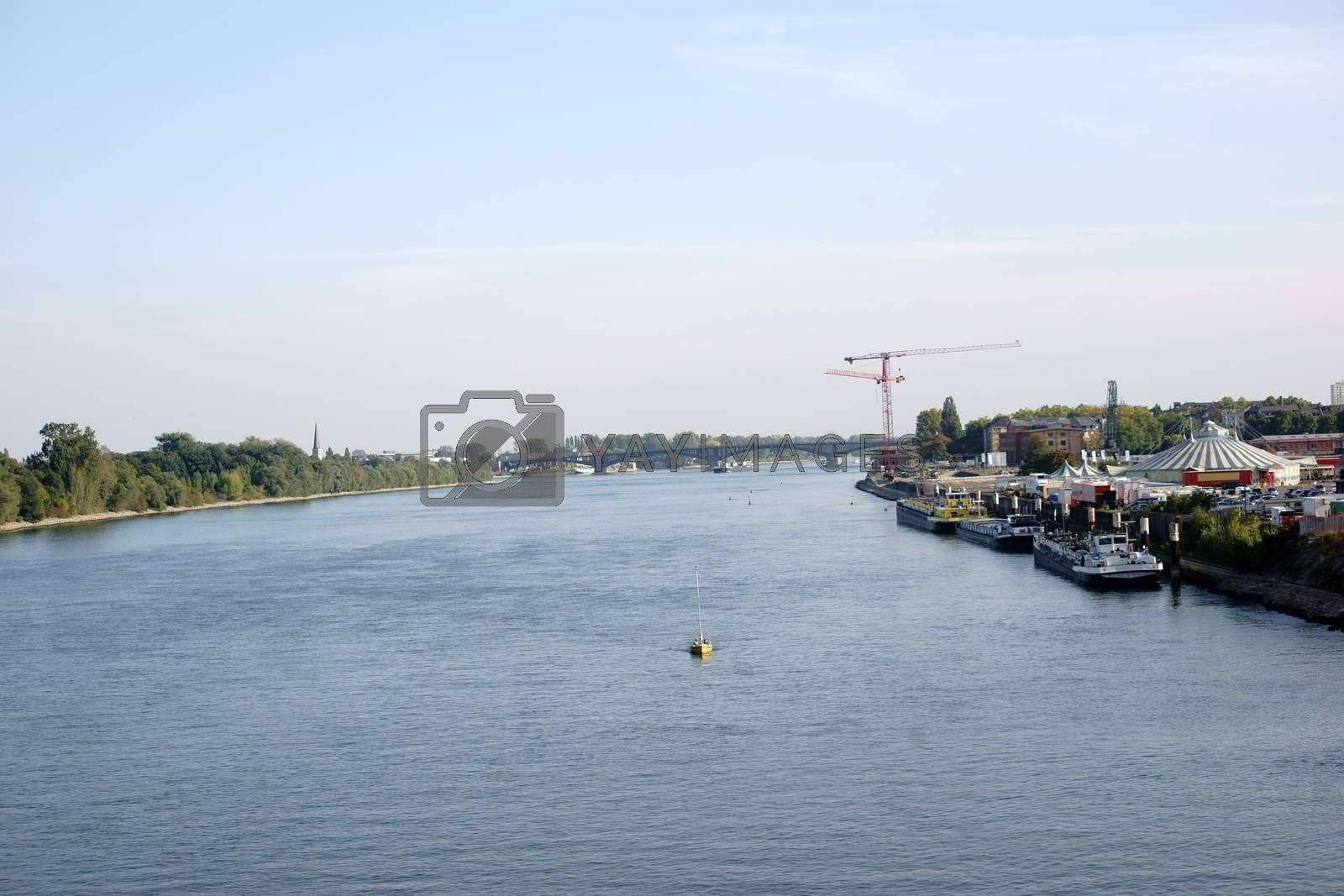 The panorama over the river Rhine at the city of Mainz with the Theodor Heuss Bridge in the background.