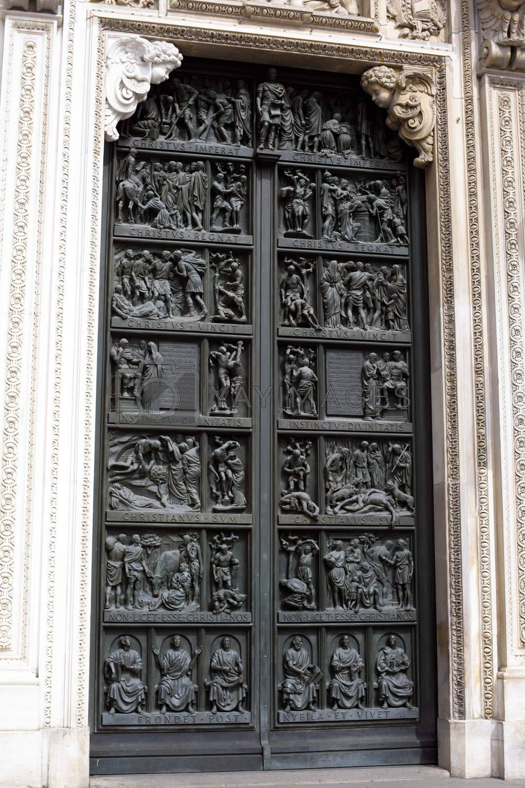 A famous gothic Milan cathedral door in Italy