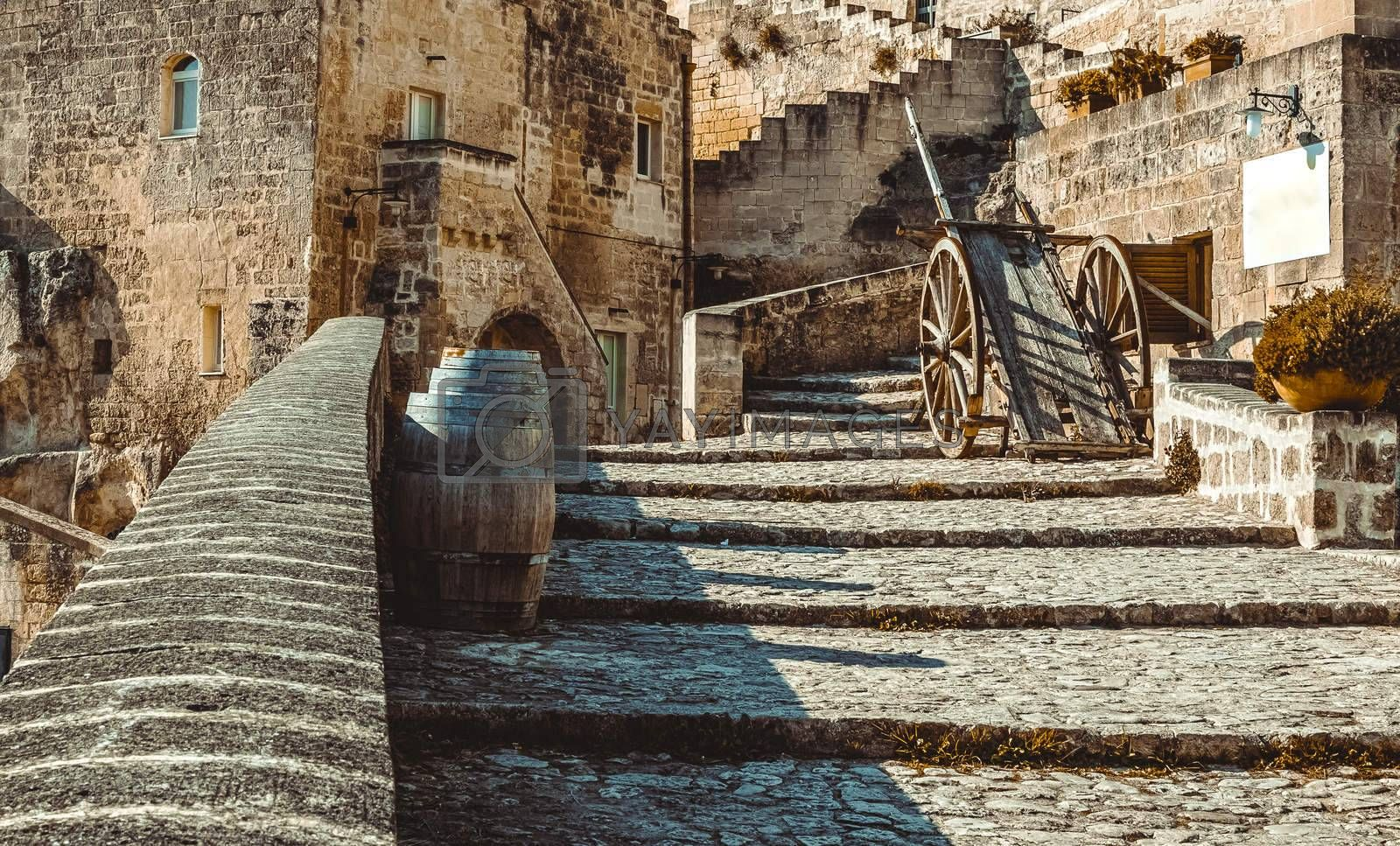 old historical scene with wood wagon and wine barrels typical tool used in the past, old style, in Matera, Italy UNESCO European Capital of Culture 2019