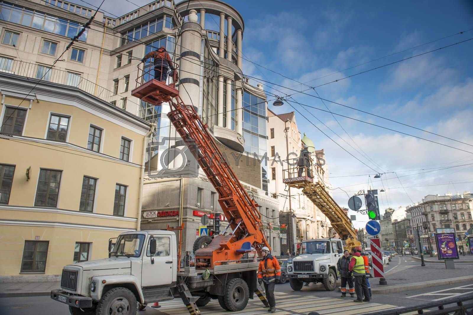 Utility workers irepairing tte electrical cable