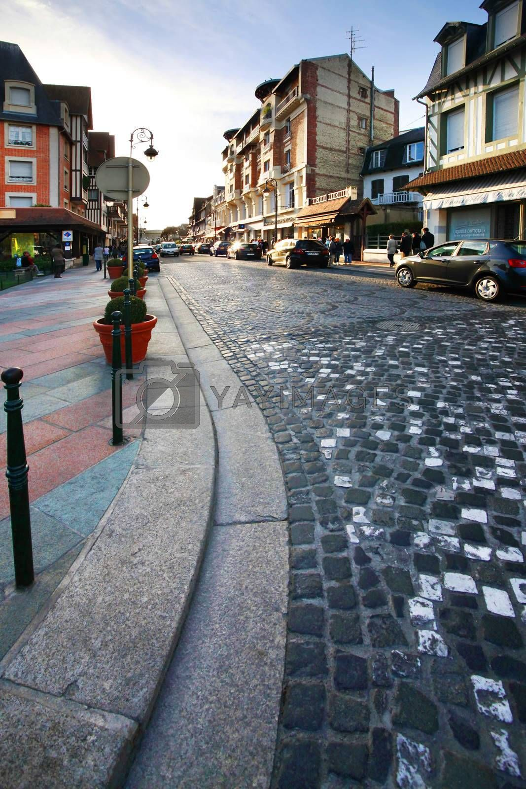 Deauville, France - September 18, 2010: beautiful street for walking on sunset in Deauville. France