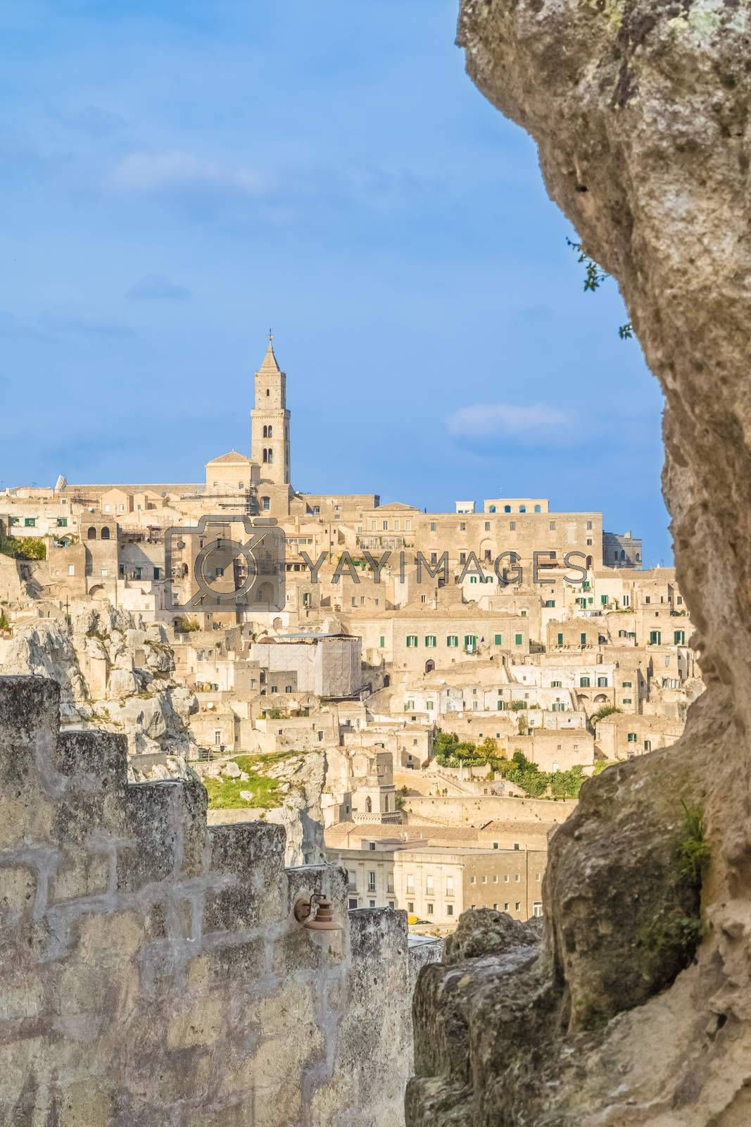 view of typical stones (Sassi di Matera) and church of Matera UNESCO European Capital of Culture 2019 under blue sky. Basilicata, Italy