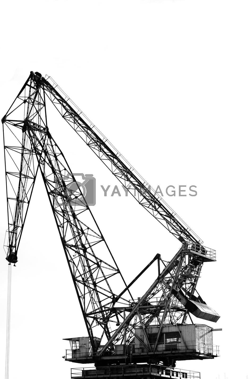 A heavy harbor crane with a cab and a container structure.