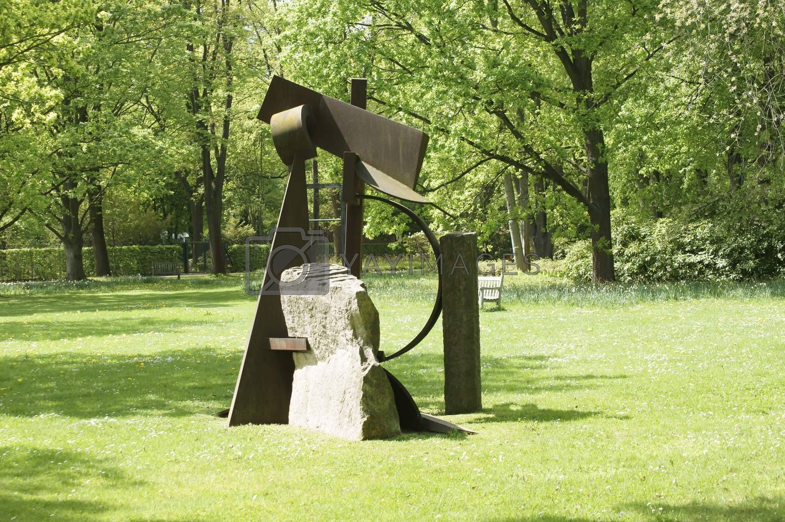 Berlin, Germany - May 06, 2015: A modern sculpture by an unknown artist stands on a meadow area of the park Britz Garden on May 06, 2015 in Berlin.