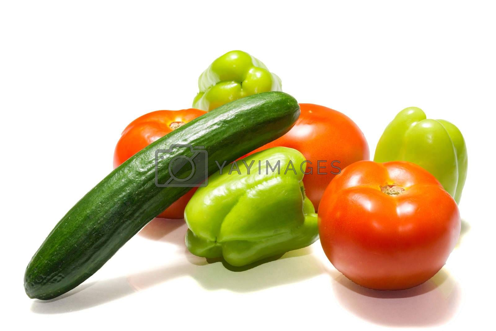 The photo shows vegetables on a white background