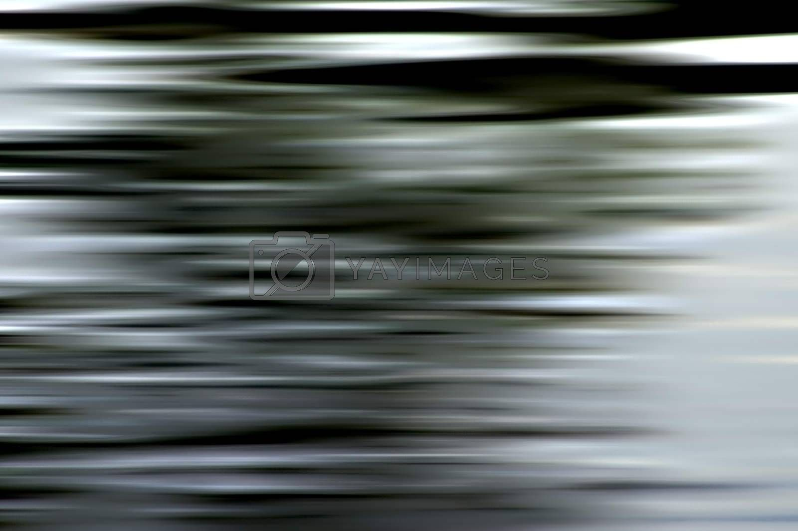 A slurred and abstract corrugated surface.