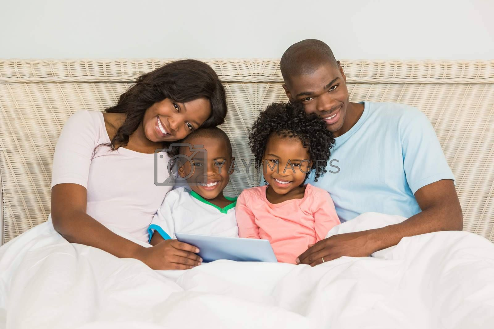Family with digital tablet in bed by Wavebreakmedia