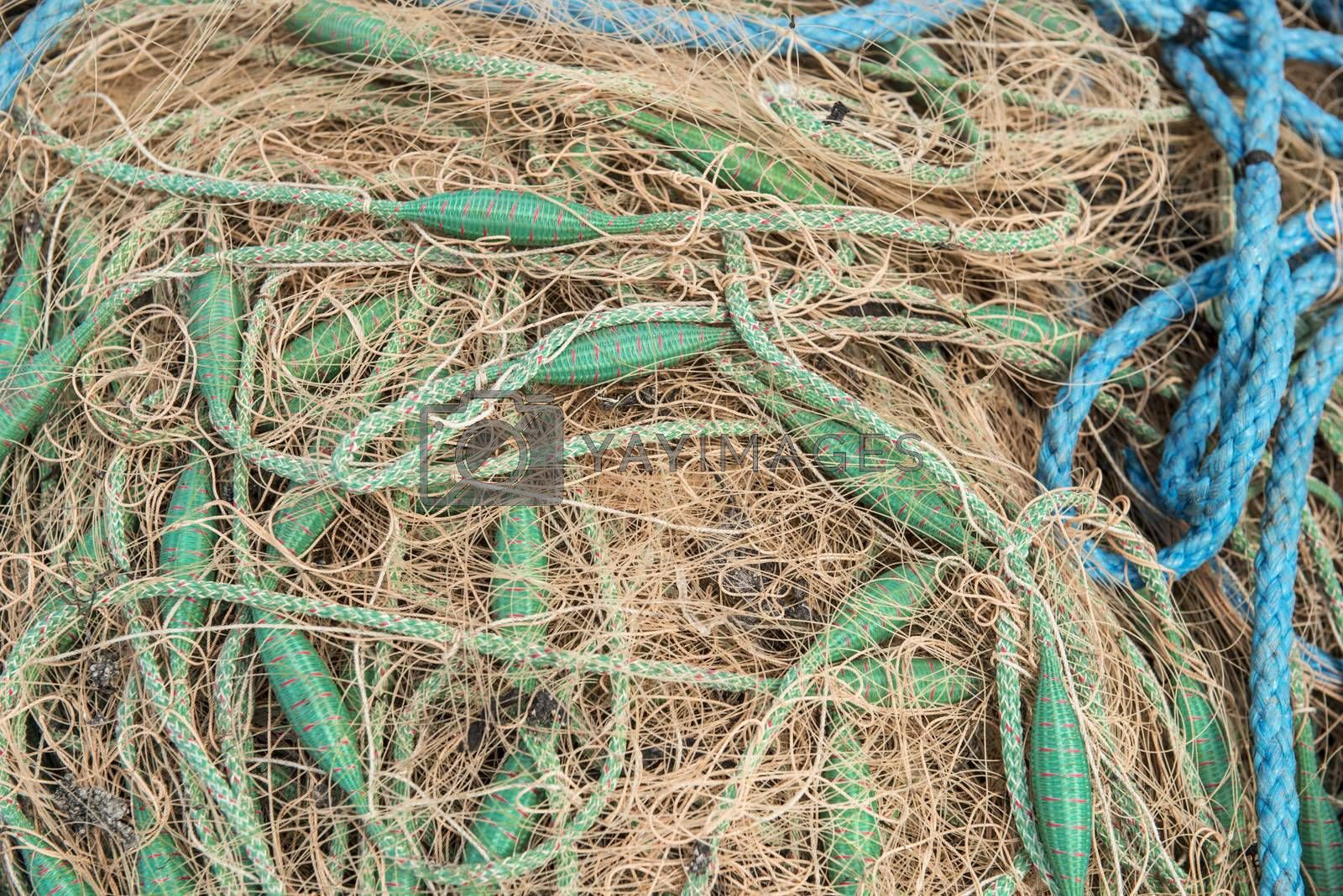 Crowded of fishing net with green and blue ropes