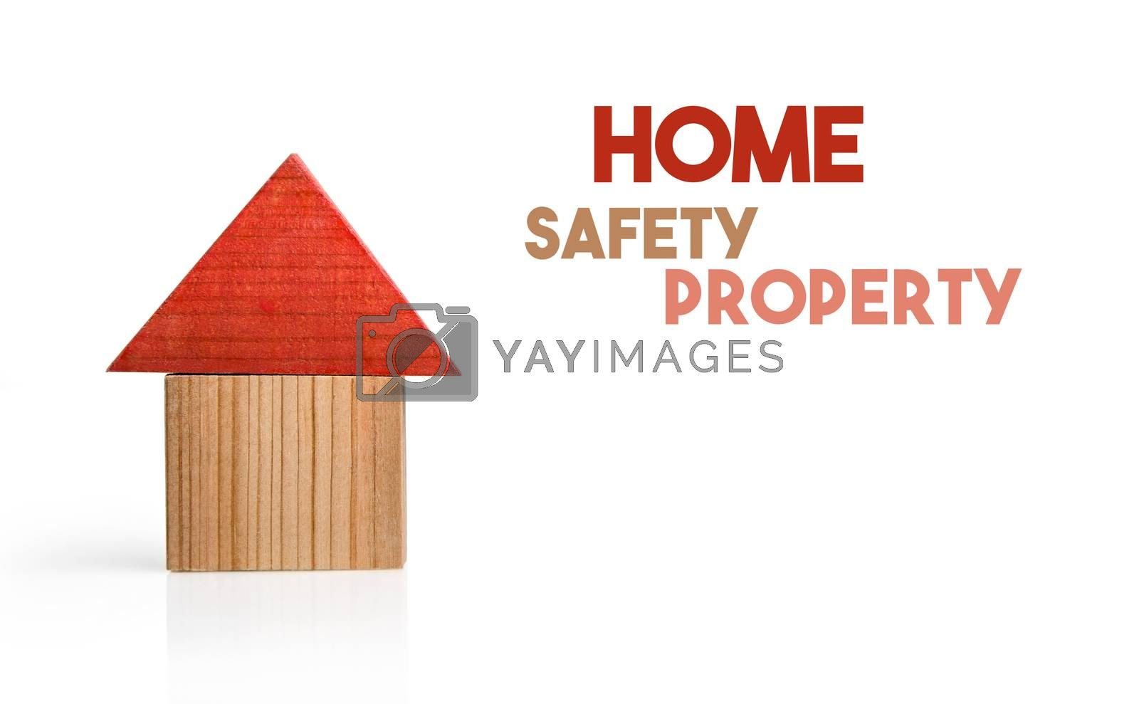 Wooden house model as a symbol of safety living.