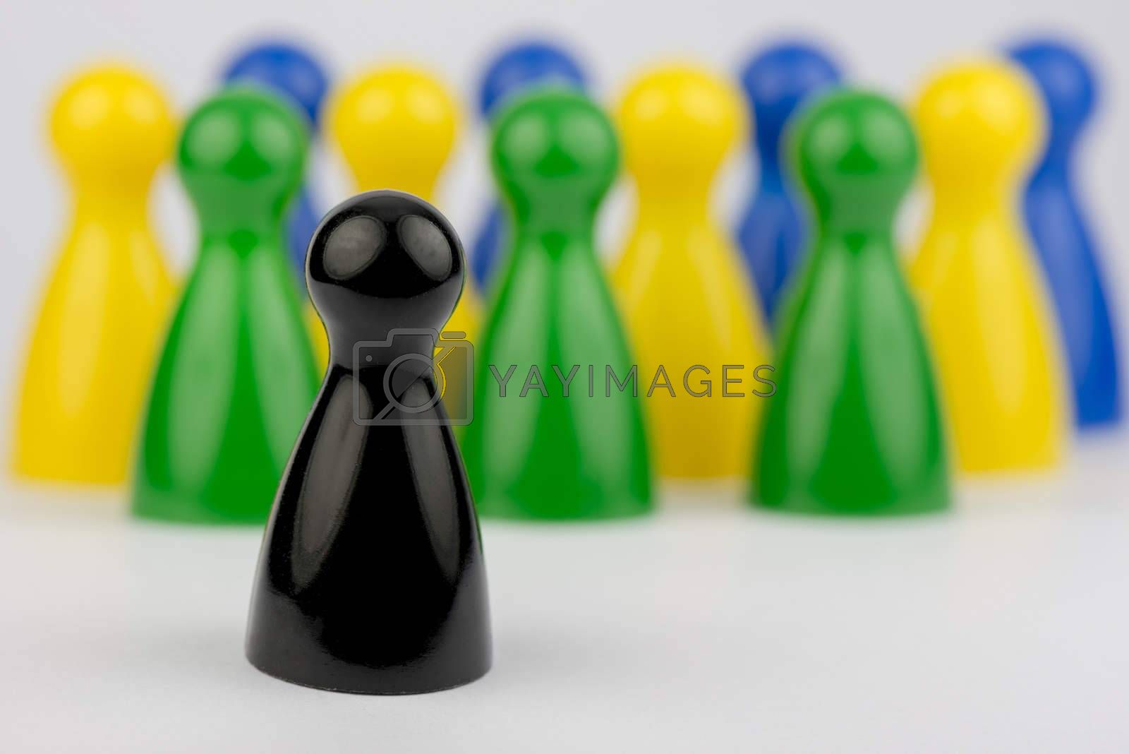 Conceptual game pawns that depict the concept different