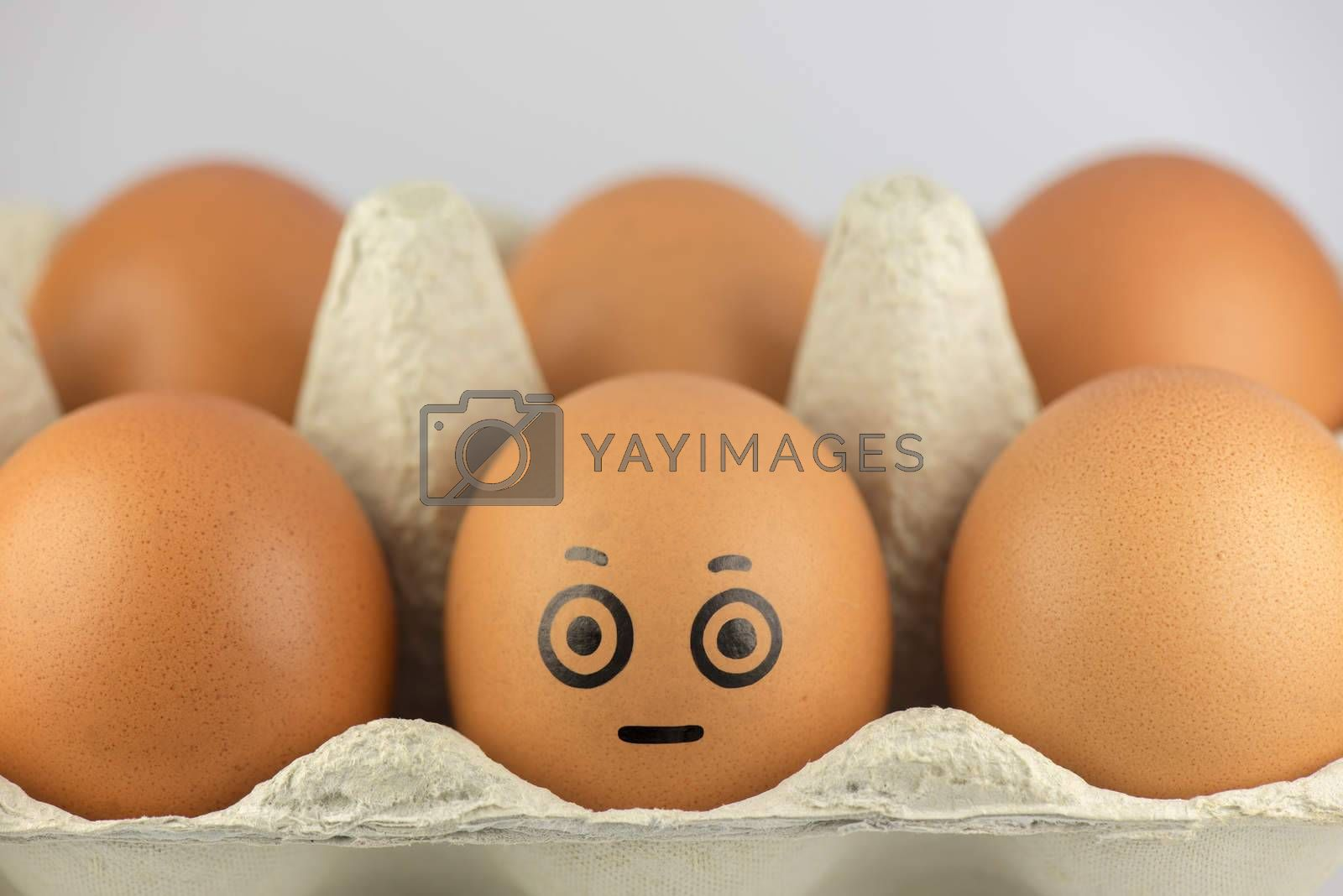 Egg with a face in a egg carton  by Tofotografie