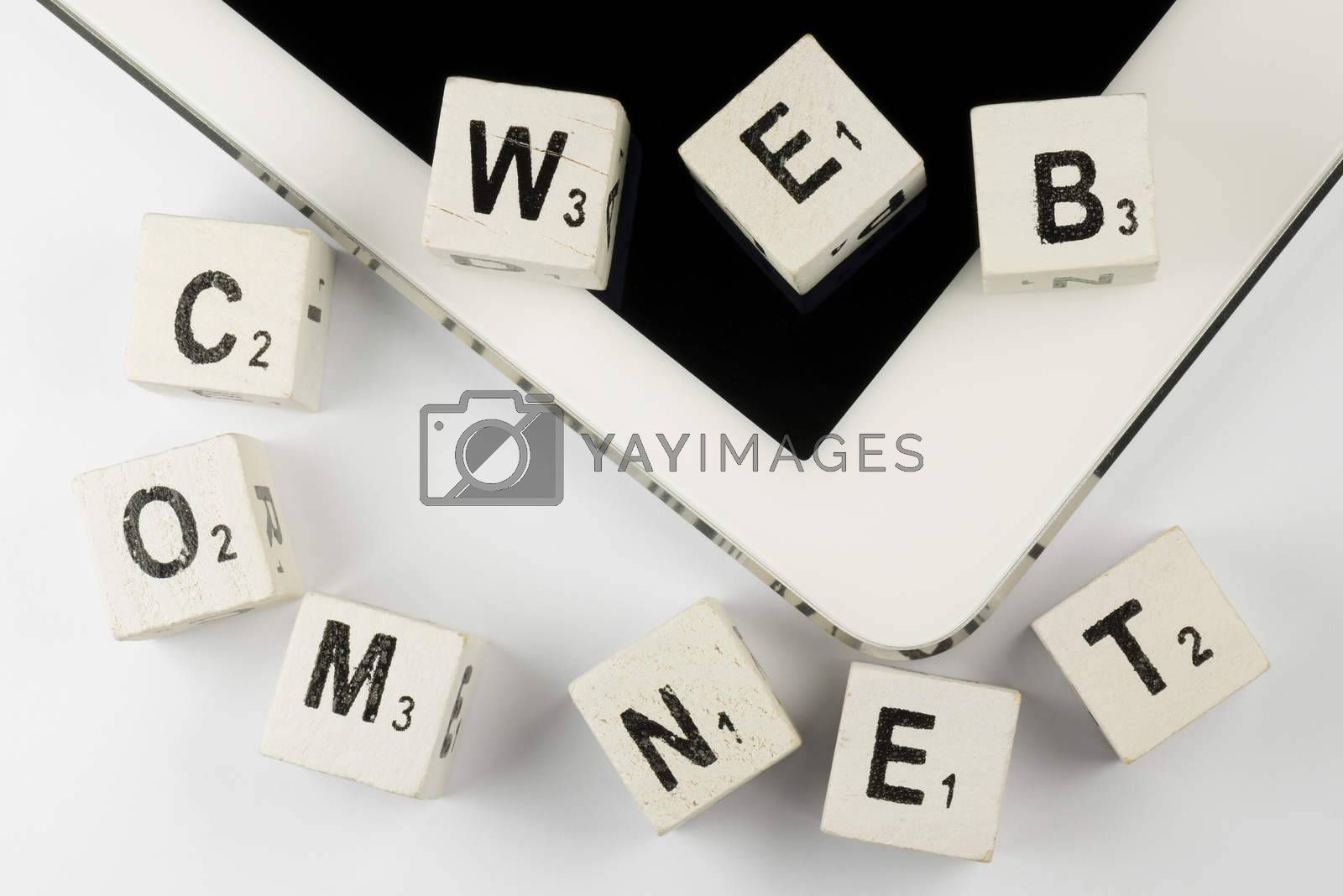 Old wooden letters, as a collage positioned on a modern tablet.