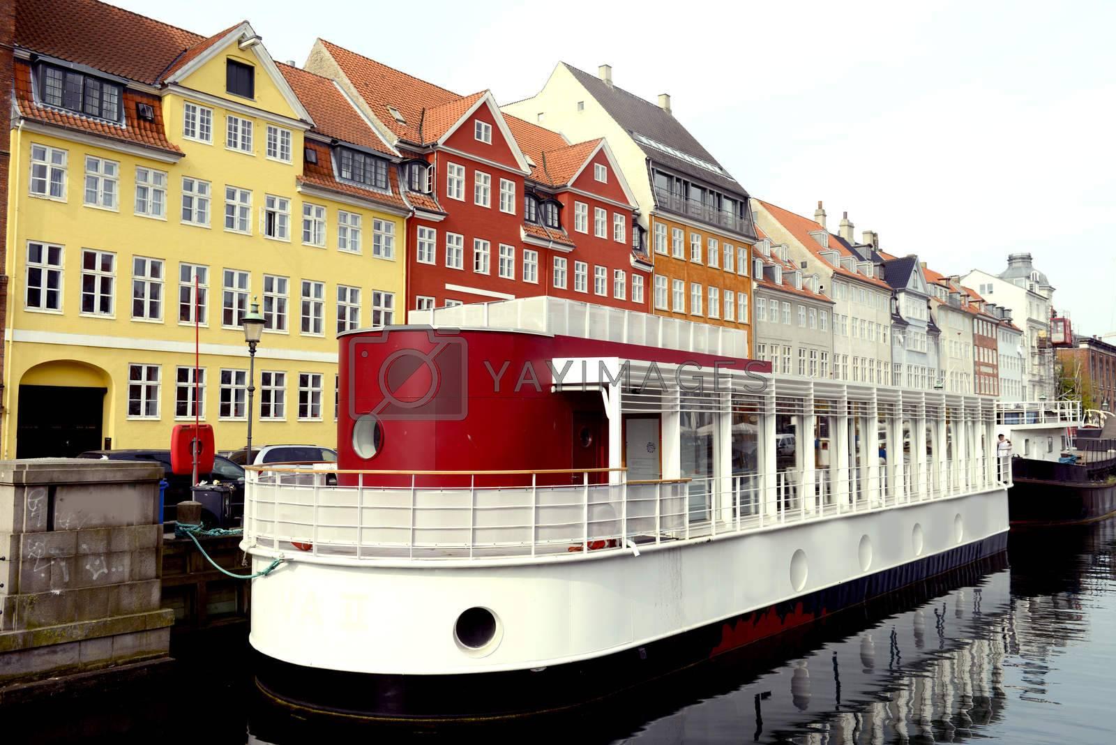 Boatsi in the canal of Nyhavn in Copenhagen, Denmark. Taken on May 2012.