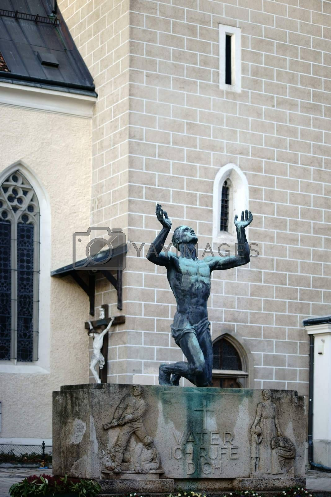 """Baden near Vienna, Austria - November 14, 2015: The sculpture """"Father, I'll call you!"""" In honor of the fallen soldiers in World War II by the artist Josef Mueller on November 14, 2015 in Baden near Vienna."""