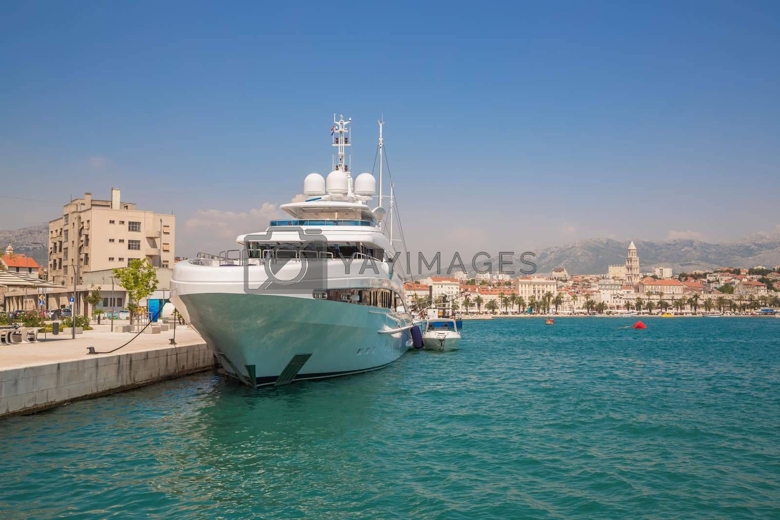 Royalty free image of Large yacht at the pier by Sid10