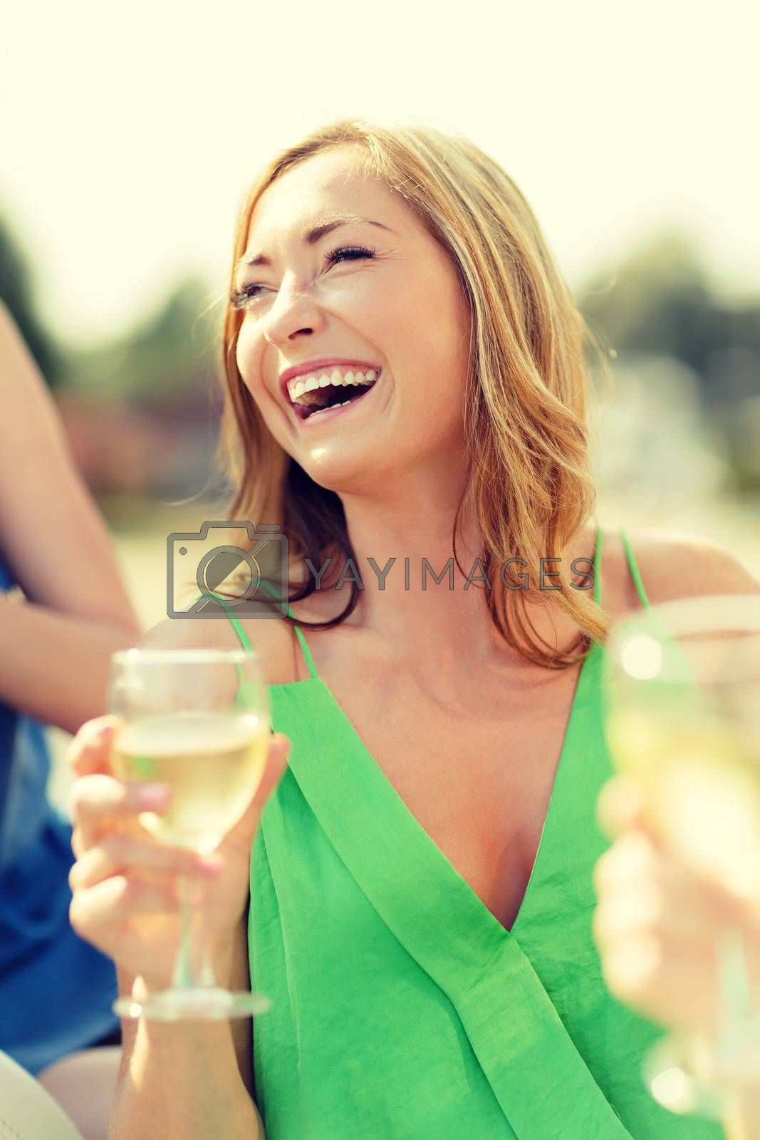 summer holidays, vacation and celebration concept - laughing woman with wine glass