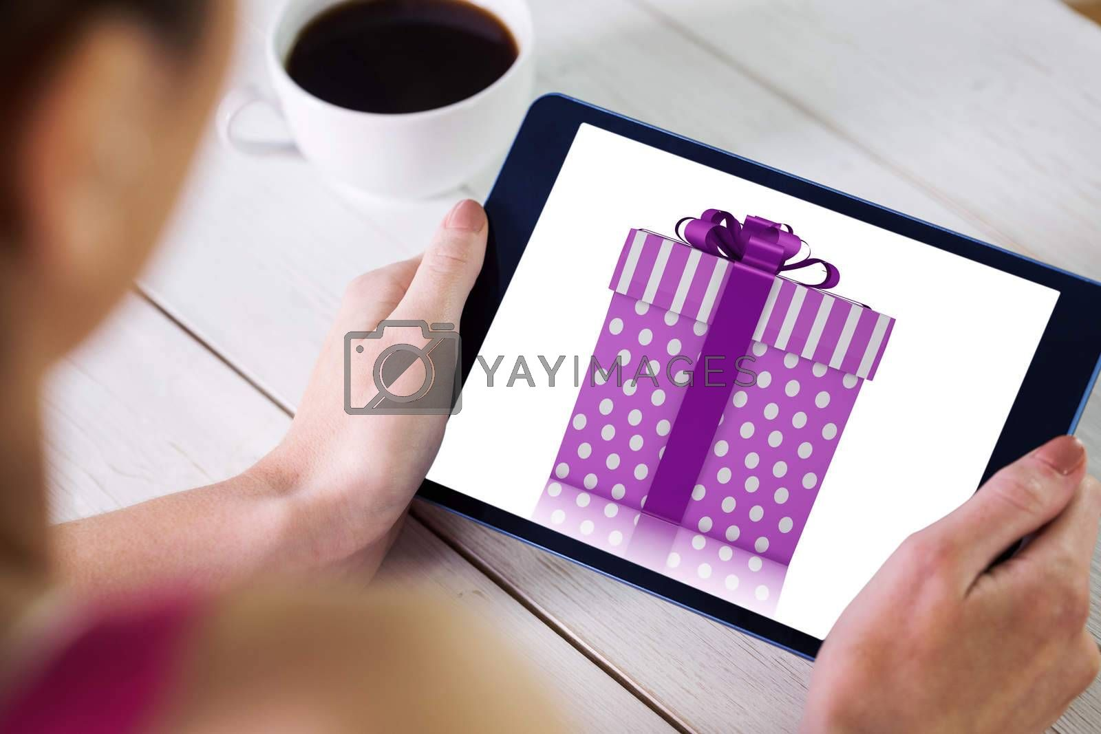 Composite image of woman using tablet pc by Wavebreakmedia