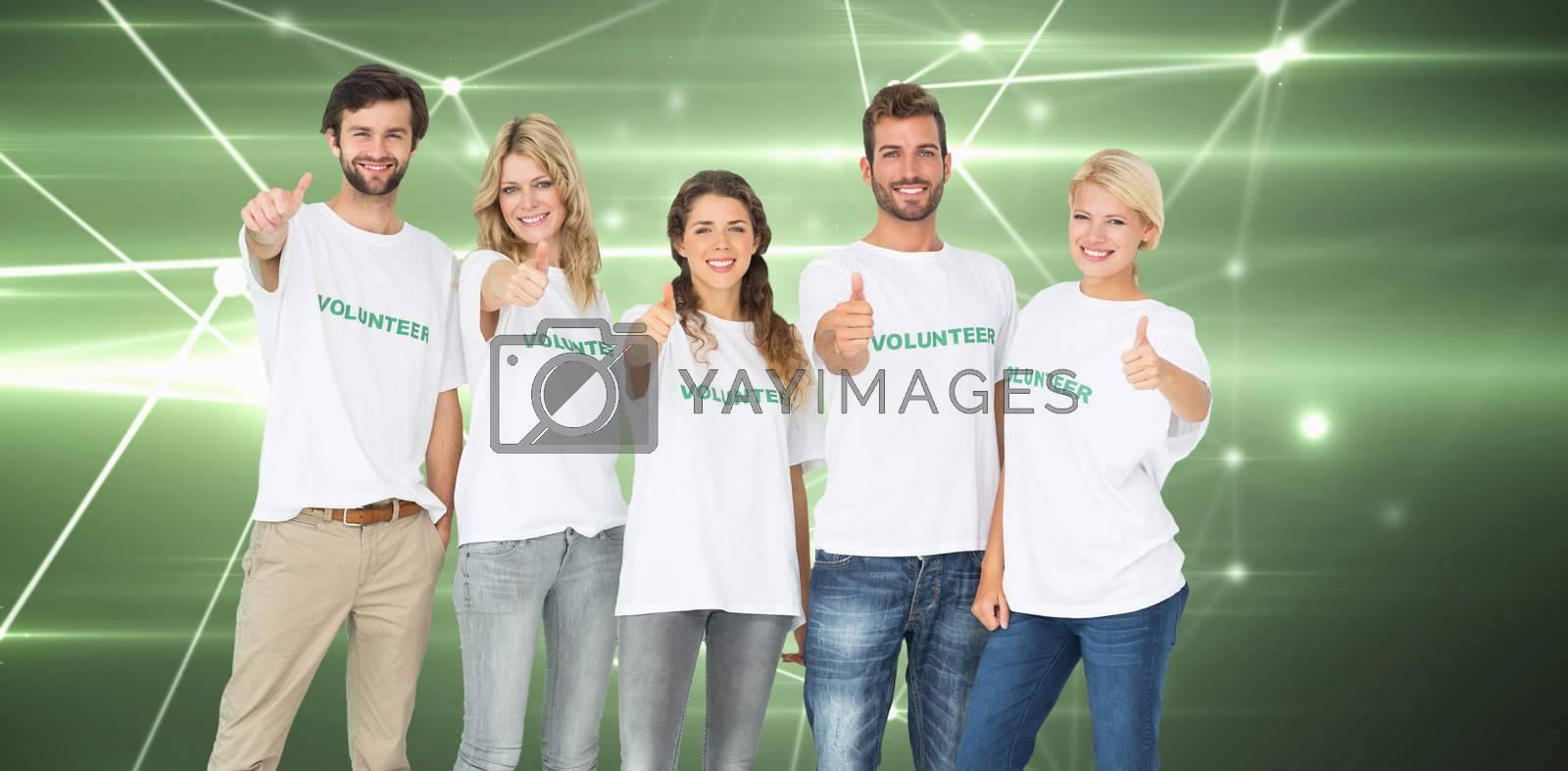 Group portrait of happy volunteers gesturing thumbs up against glowing geometric design