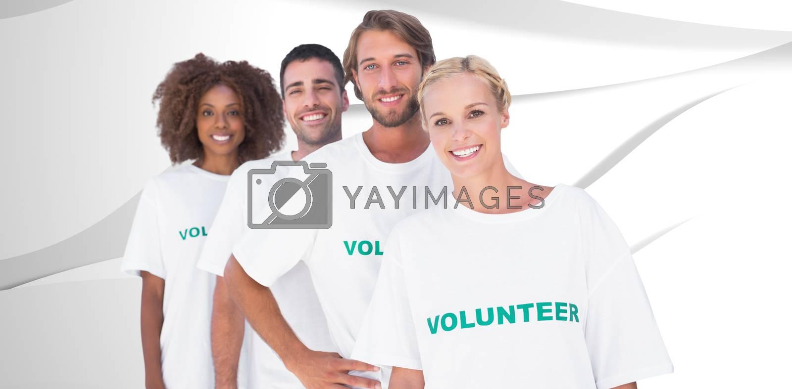 Smiling volunteer group against white wave design