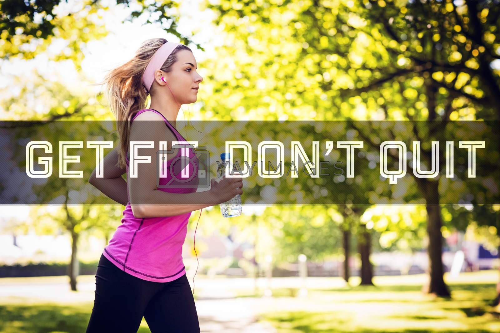 Royalty free image of Composite image of fit blonde jogging in the park by Wavebreakmedia