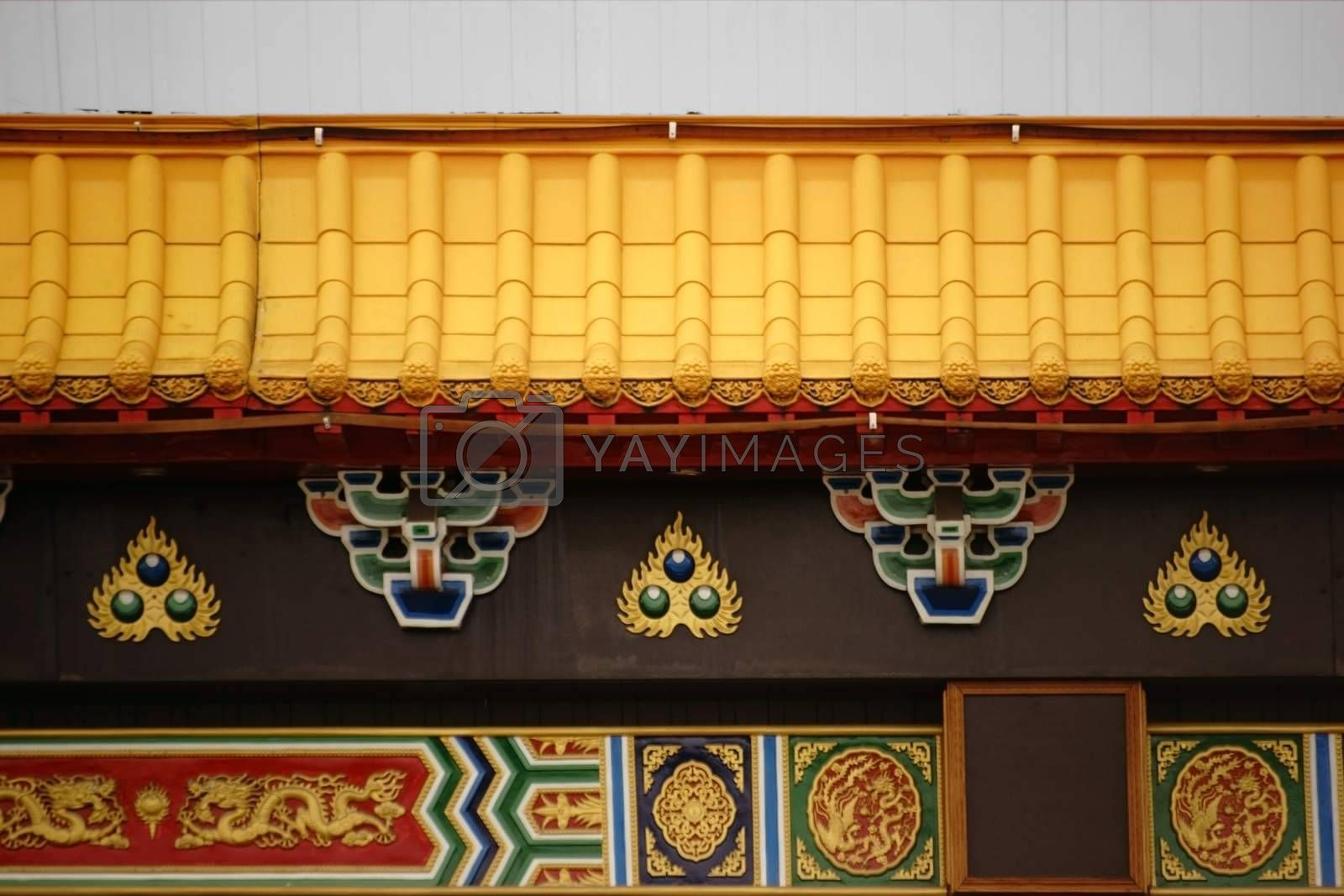 The ornate facade of a Chinese restaurant with dragons� ornaments and symbols.