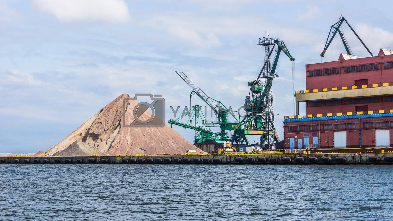 Heap of gravel on the quay, on July 10, 2013, in the Port of Gdynia - the third largest seaport in Poland, specialized in handling containers, ro-ro and ferry transport.
