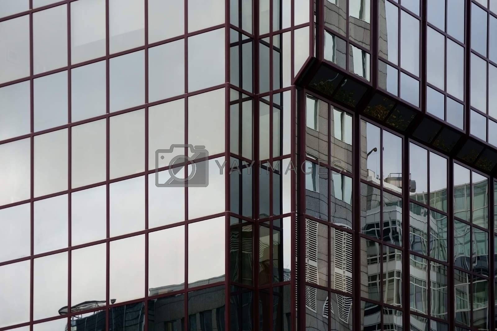 The reflection of buildings in the modern mirror facade of an office building and residential building.