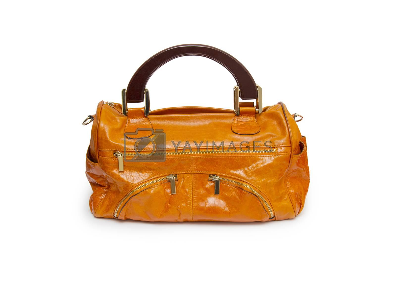 Royalty free image of Orange female handbag isolated on white background. by cocoo