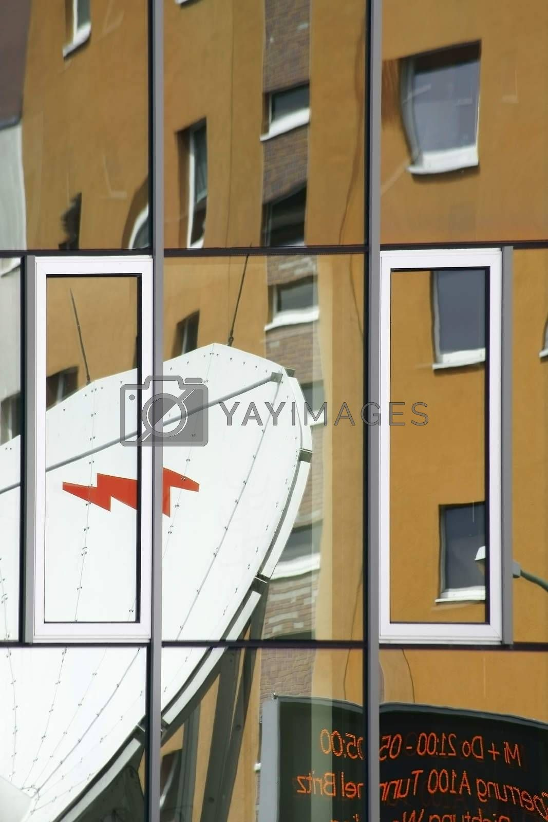 The abstract photograph of reflections in windows.