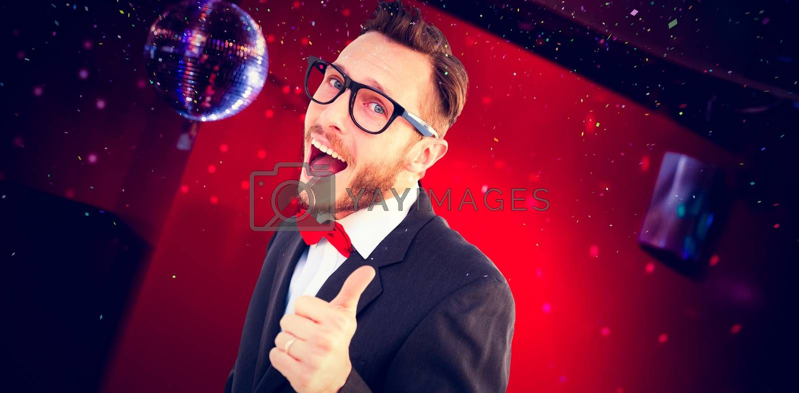 Geeky hipster pointing at camera against pretty brunette dancing and smiling