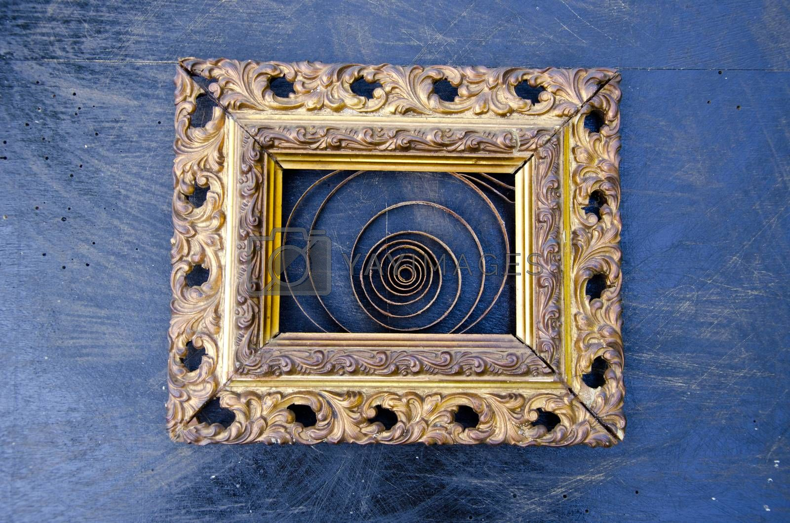 Royalty free image of Golden ornate frame with a spiral on black background by alis_photo