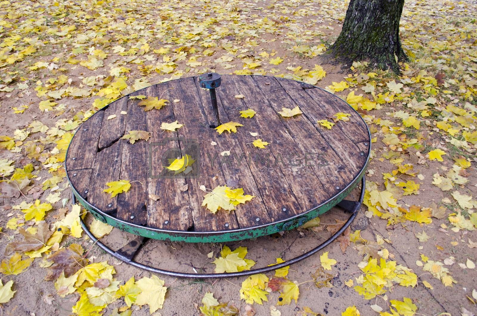 Royalty free image of Old used wooden children?s playground toy in autumn by alis_photo