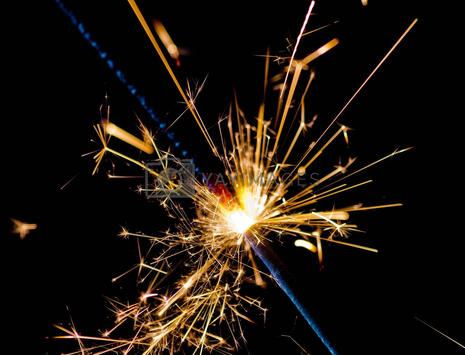 close-up of firework sparkler burning on black background, congratulation greeting  party happy new year,  christmas celebration concept