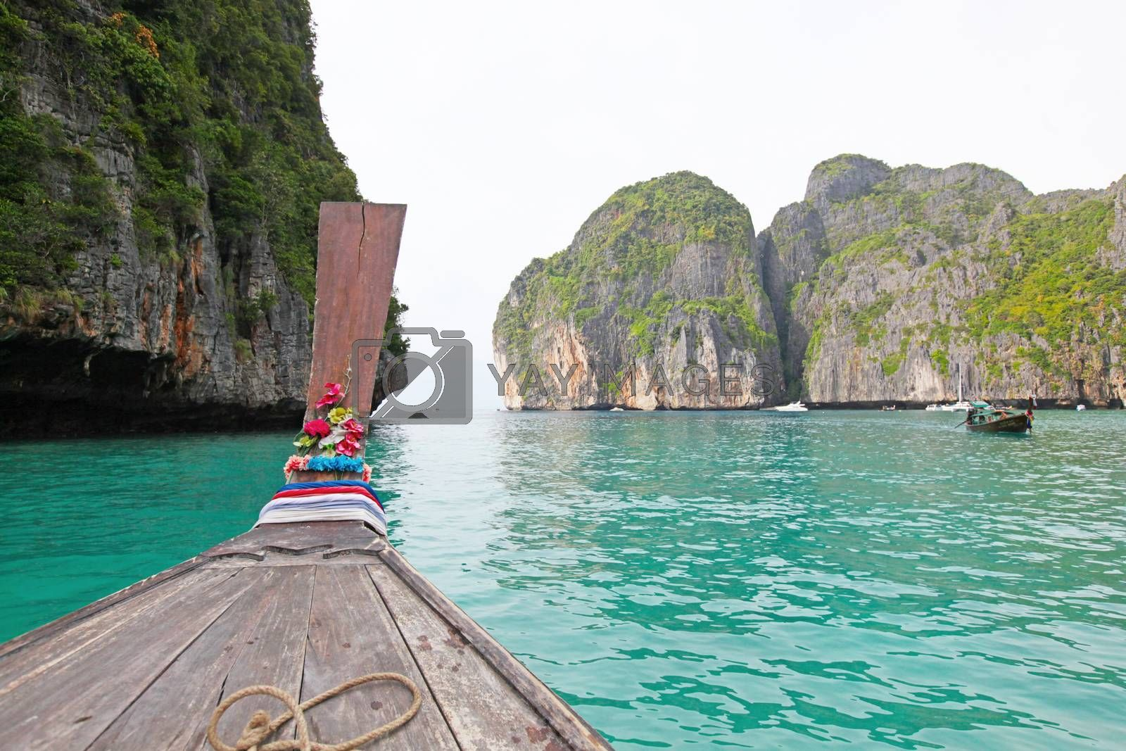 Traditional wooden thai boat in a picture perfect tropical bay