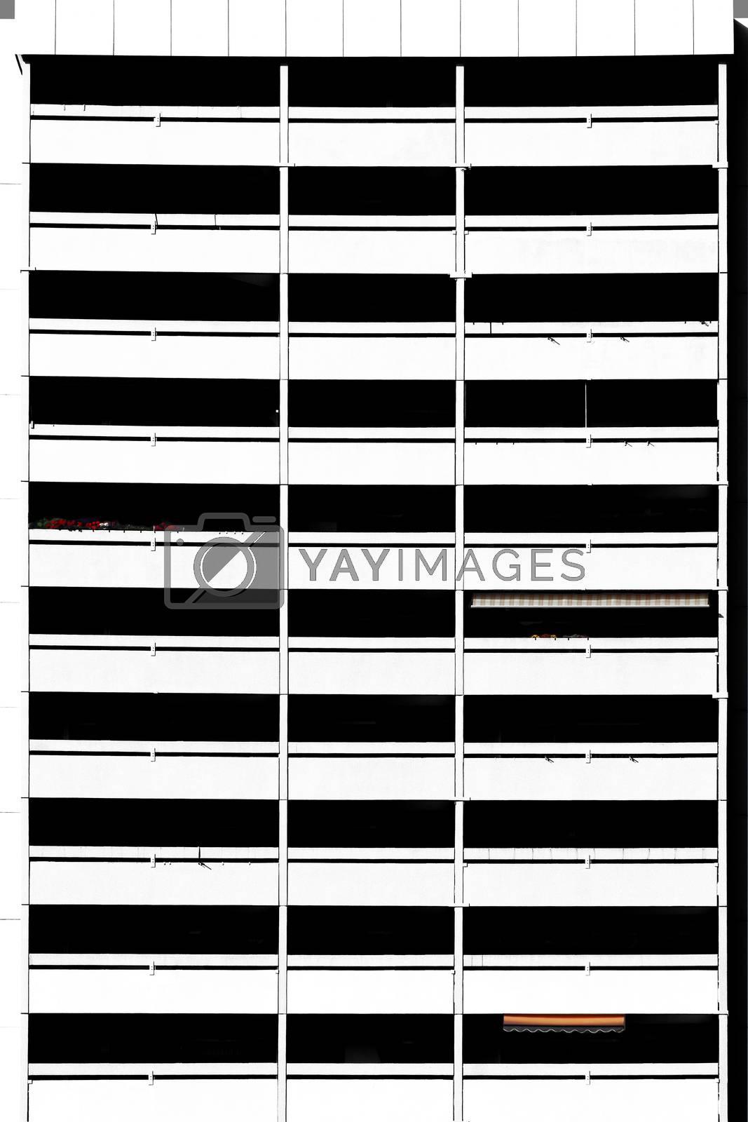 The photograph of a skyscraper facade with symmetrical balconies.