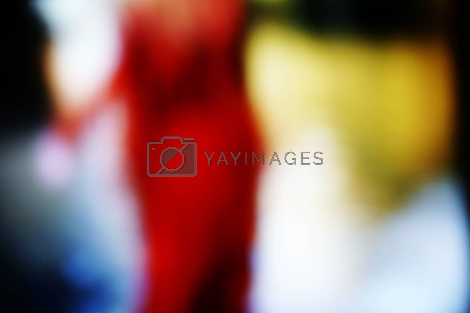 The blurred photograph of a woman in red dress, which moves away.