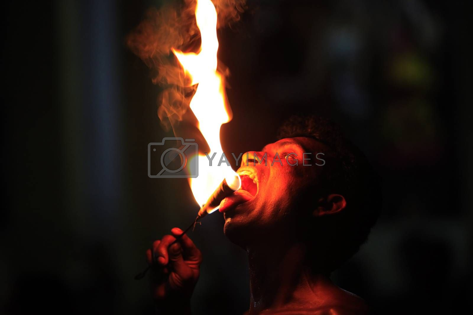 Kandy, Sri Lanka - 03 April, 2011: Show of swallowing of fire for tourists in city Kandy 03 April 2011 on Sri Lanka