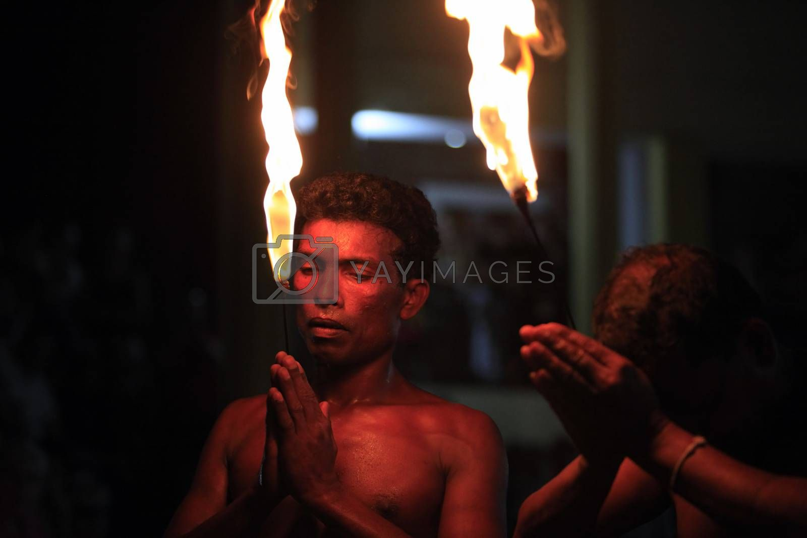 Kandy, Sri Lanka - April 3, 2011: Show of swallowing of fire for tourists in city Kandy 3 April 2011 on Sri Lanka