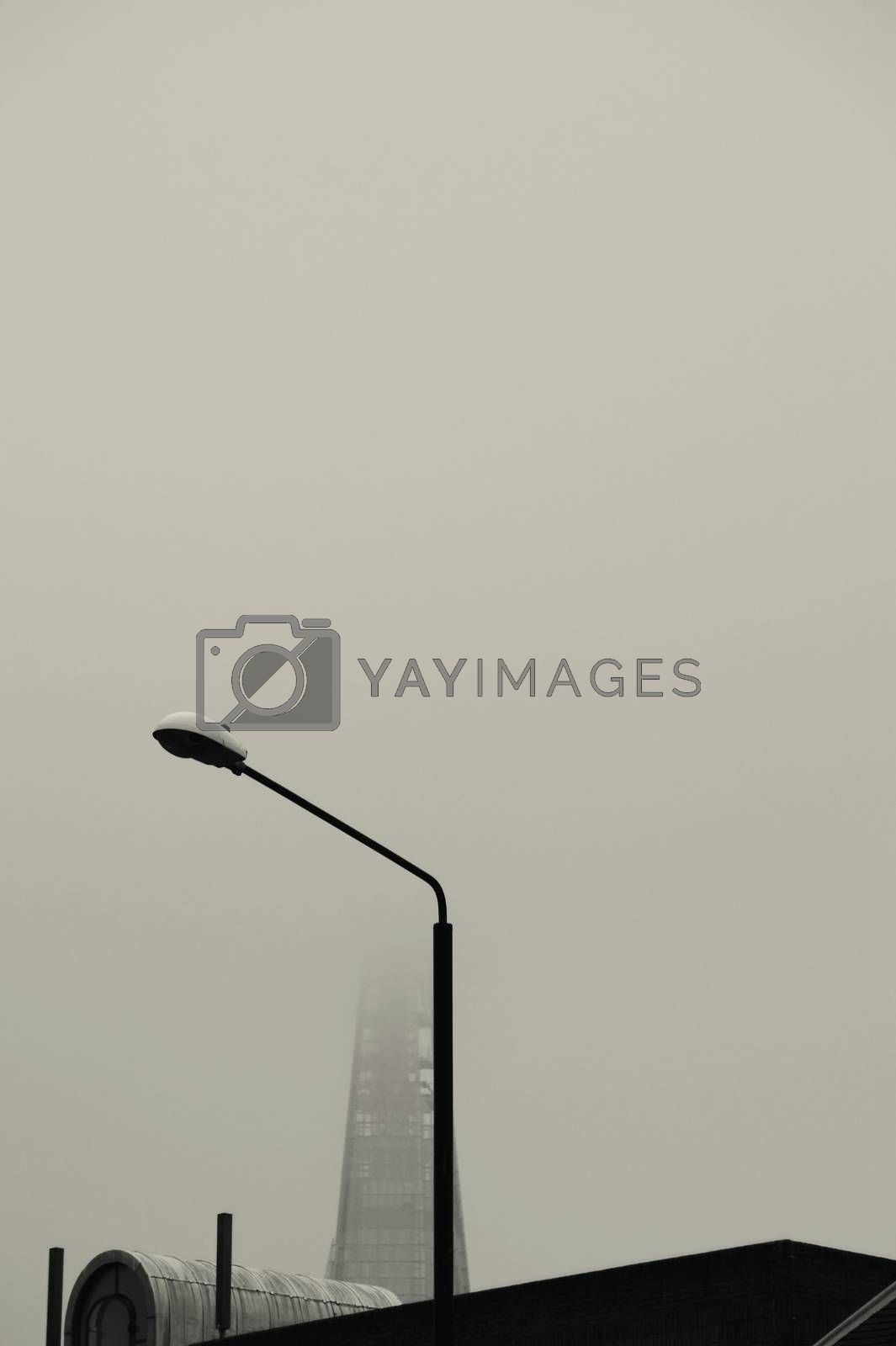 The Shard, a skyscraper in London in the fog.