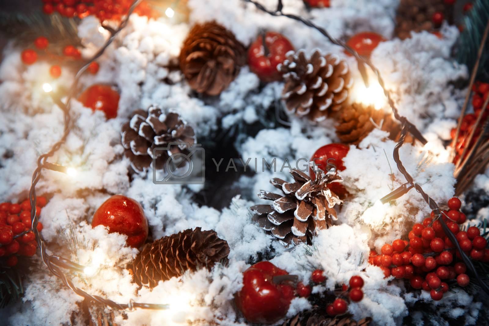 Christmas wreath and light. Close-up horizontal photo