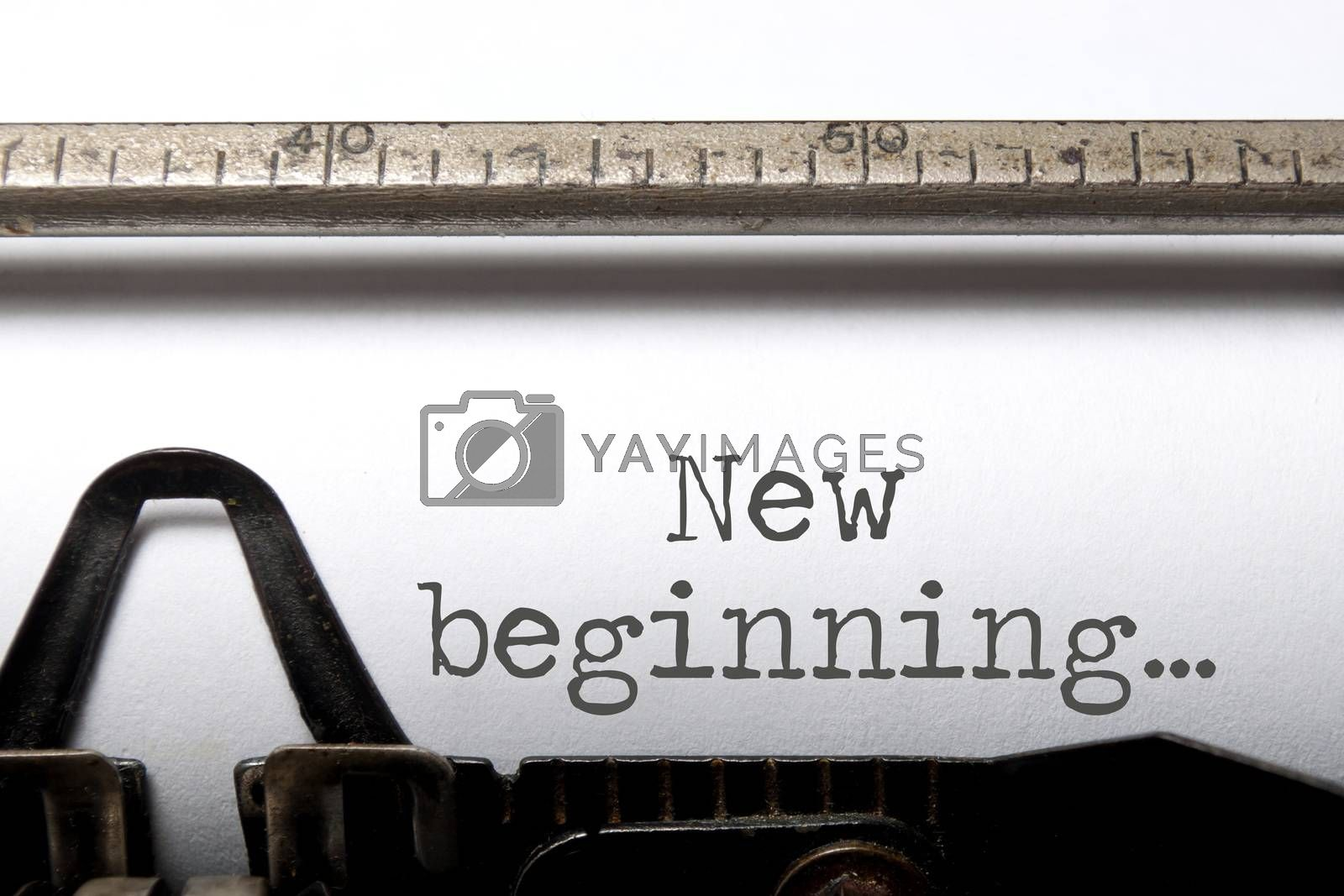 New beginning printed on an old typewriter