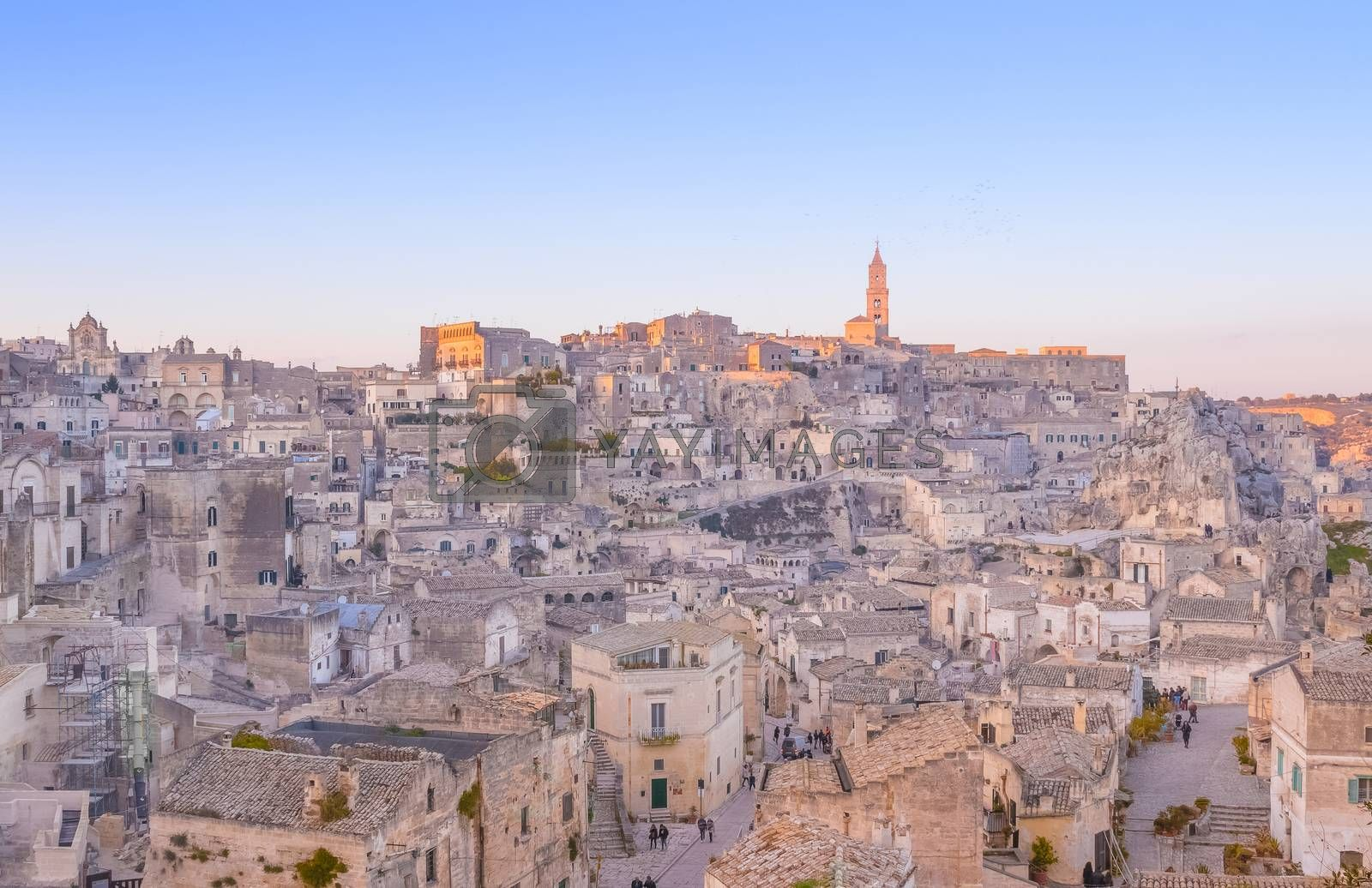 panoramic view of typical stones and church of Matera and the Madonna de Idris under begin sunset sky. Basilicata, Italy