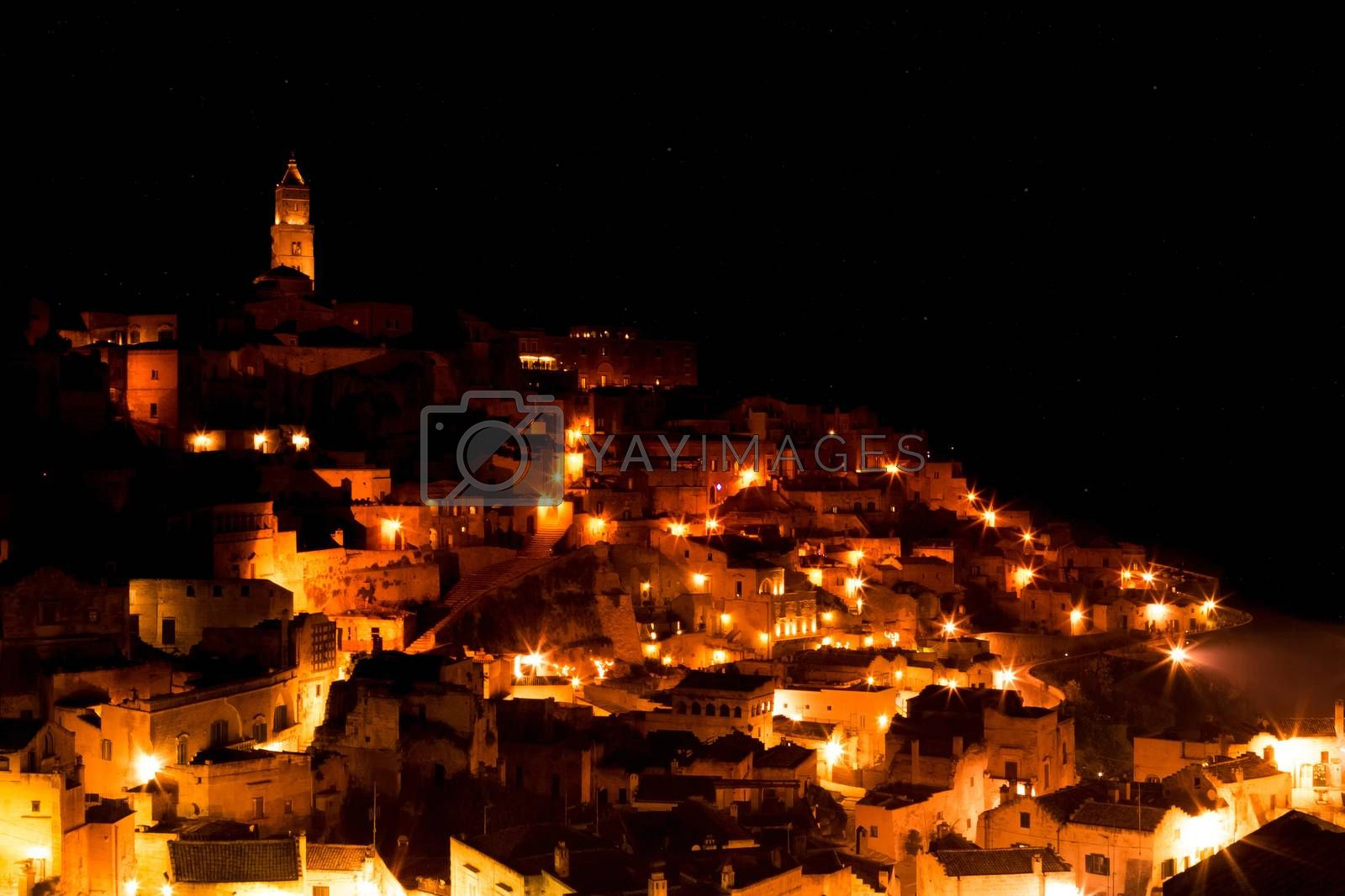 panoramic view of typical stones (Sassi di Matera) and church of Matera UNESCO European Capital of Culture 2019  at night with stars