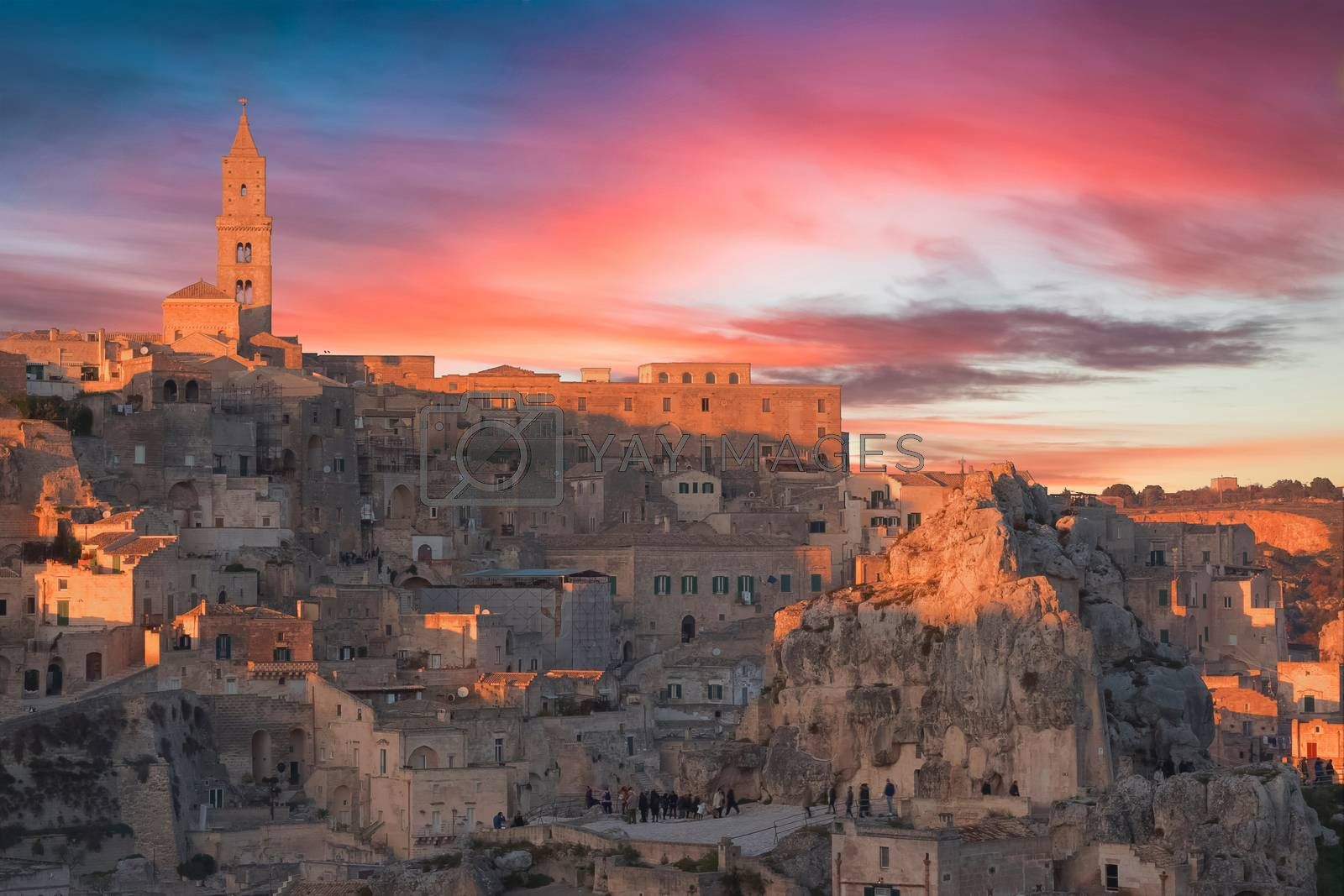 panoramic view of typical stones and church of Matera and the Madonna de Idris under sunset sky. Basilicata, Italy