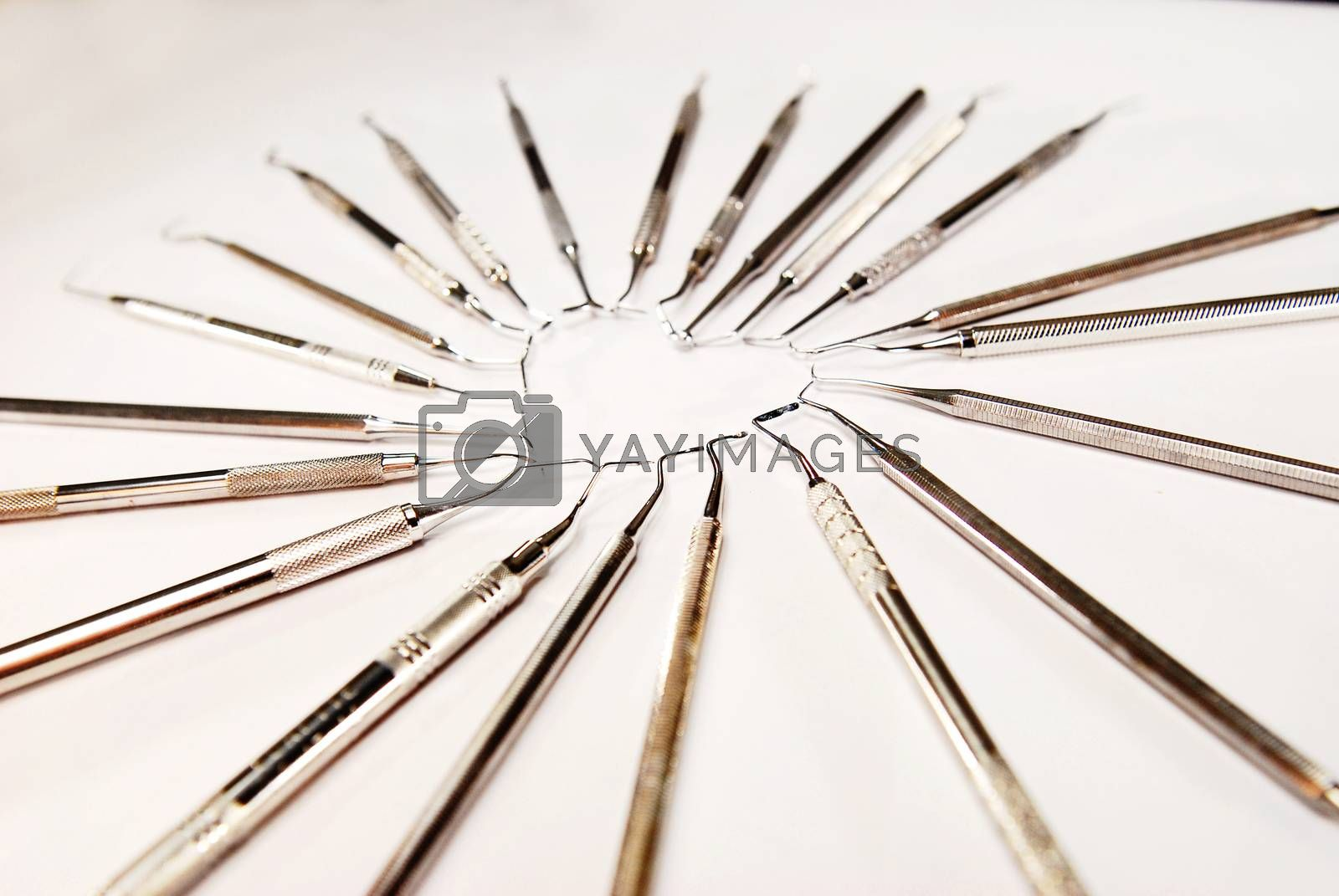Dental instruments in heart shape on white background