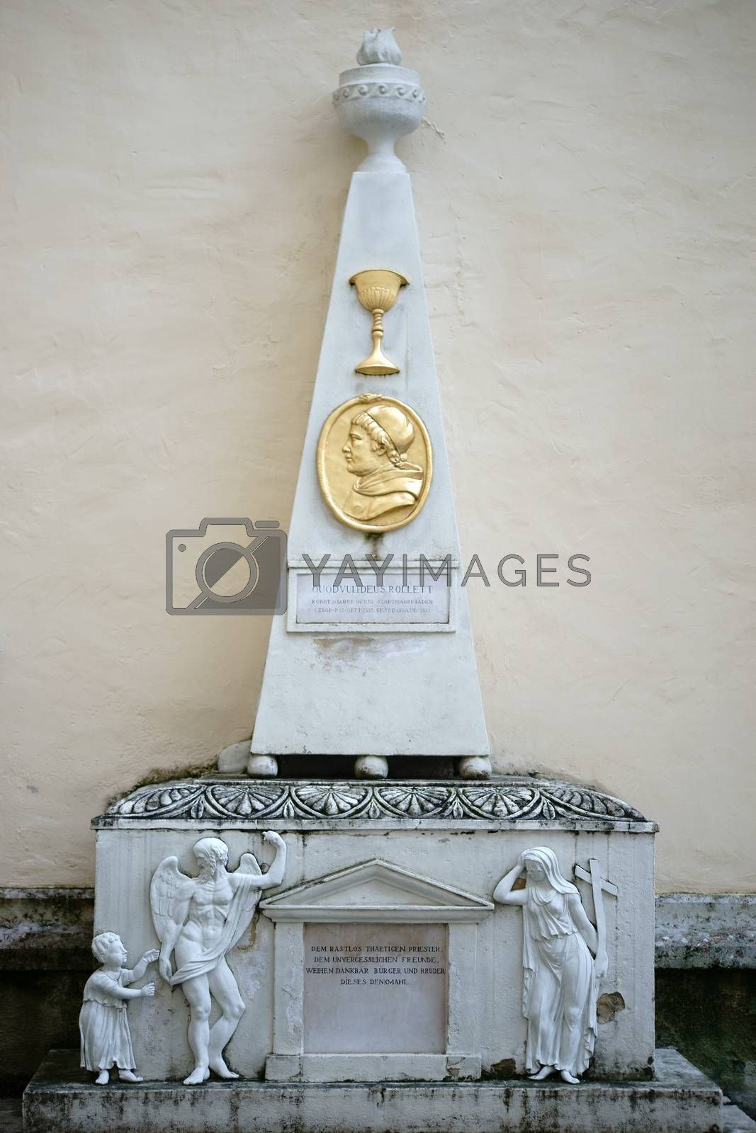 Baden, Austria - November 14, 2015: With angels and gold jewelry decorated monument to the priest Ouodvultdeus Rollett at the Church of St. Stephan on November 14, 2015 Baden near Vienna.