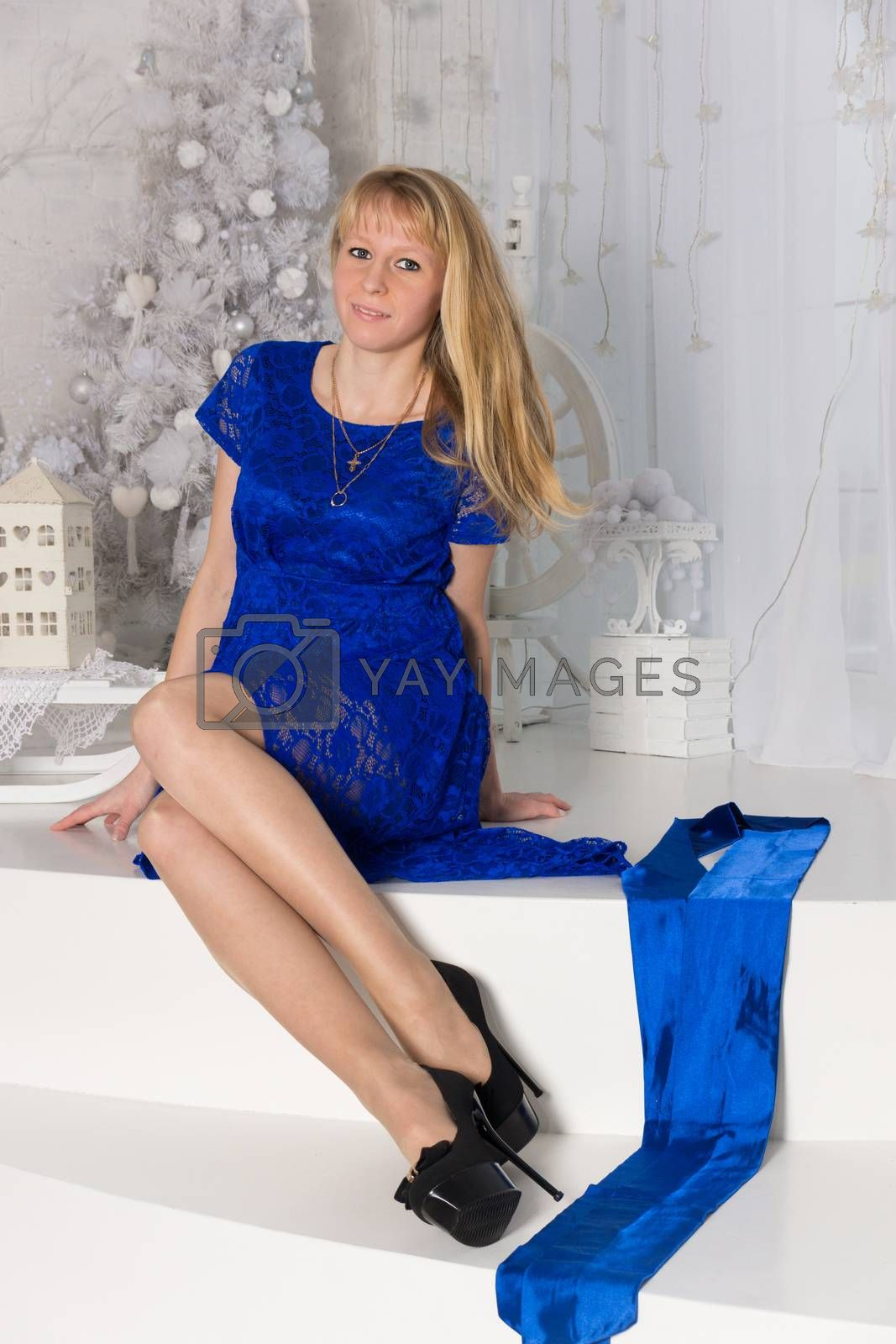 The photo shows a girl sitting on the stairs
