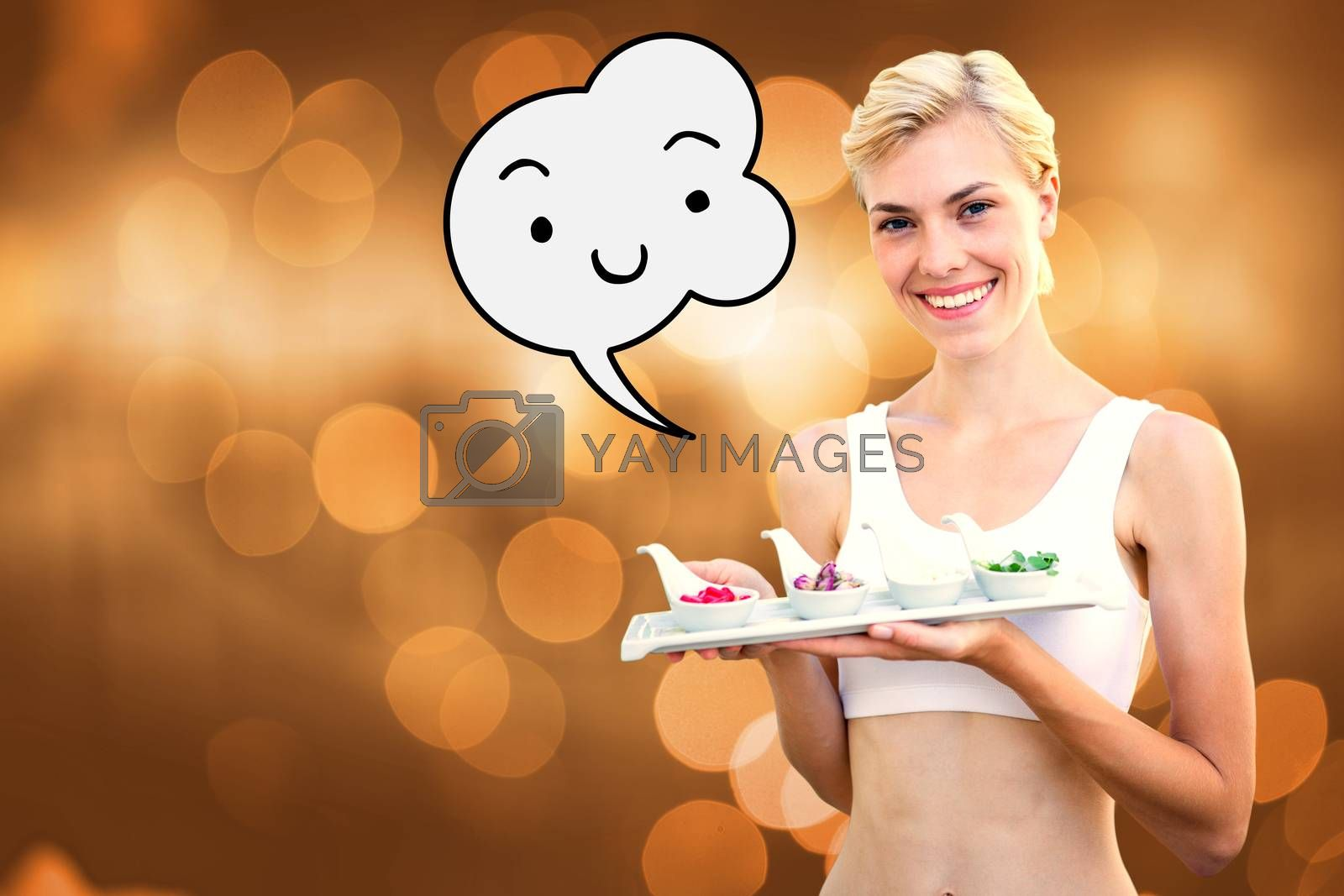 Happy blonde woman holding plate with herbal medicine against glowing background